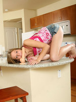 chastity with long legs spreads on the kitchen and plays her dildo