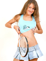 athletic hot babe pops out her luscious teen boobs as she practice her tennis strokes